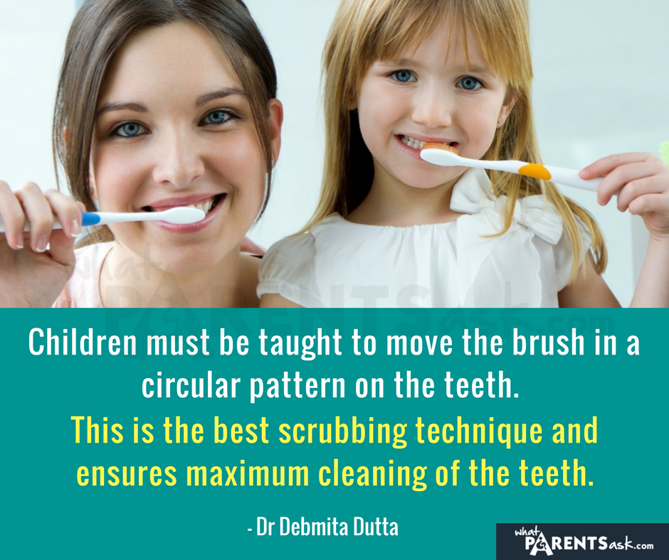 how should children brush their teeth